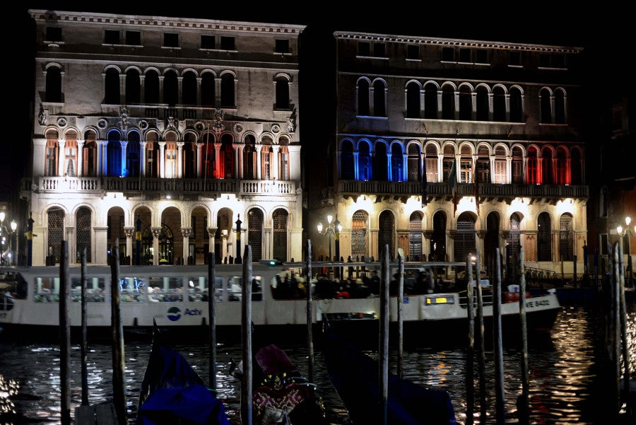 The Venice town council building is lit in red white and blue in solidarity with Paris. (Photo: Manuel Silvestri/Polaris/Newscom)