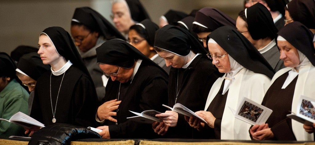 Nuns from around the world pray together during the opening mass. (Photo: Massimiliano Migliorato/Newscom)