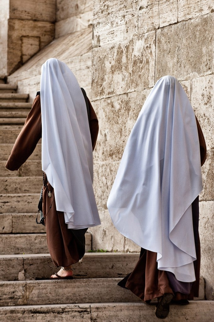 Two nuns make their way up the steps of St. Peter's Basilica. (Photo: Massimiliano Migliorato/Newscom)