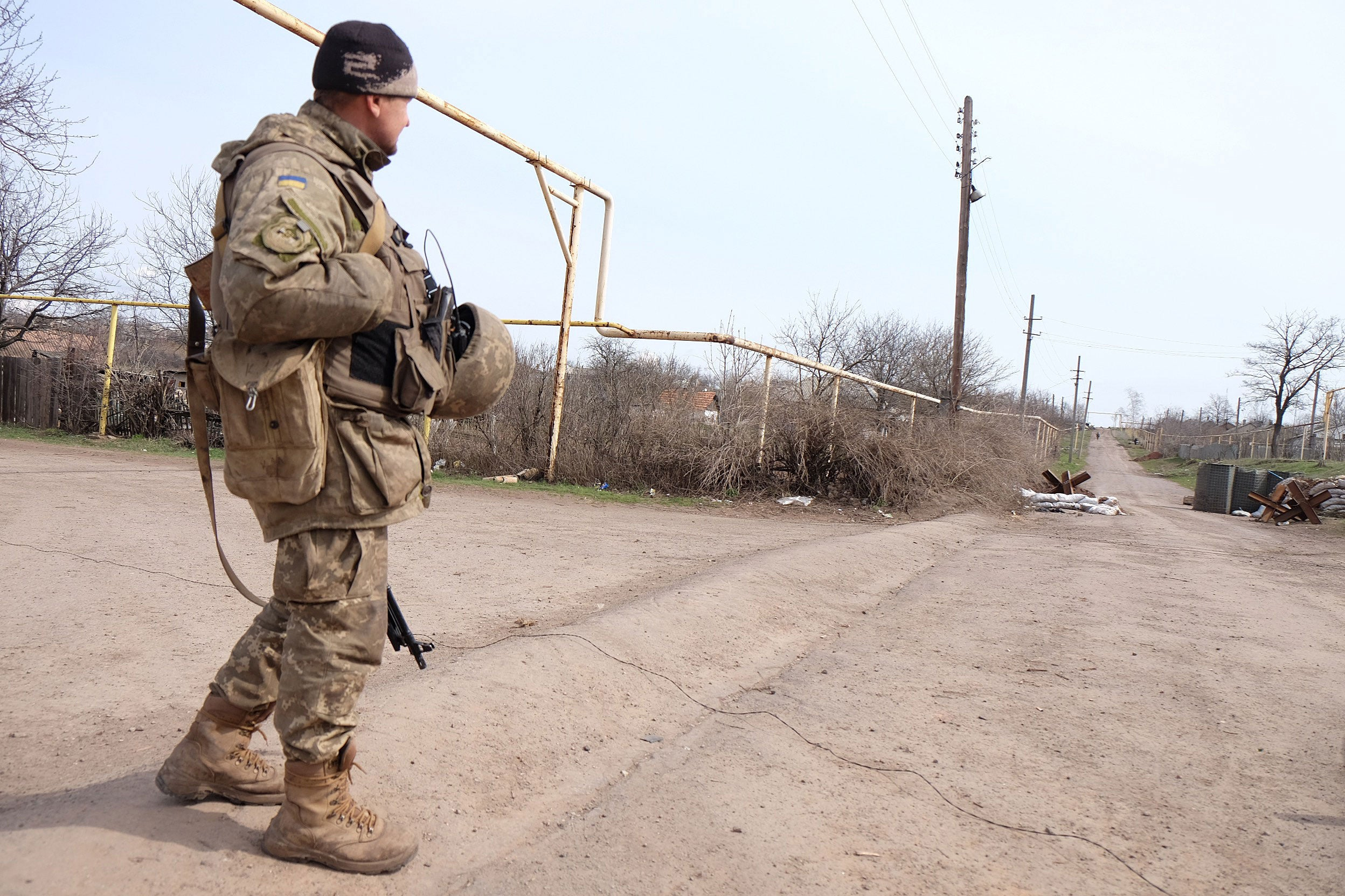 A Ukrainian soldier walks on the front lines in front of separatist positions, Zaitseve, Ukraine, April 4, 2016. (Photo: Jonathan Alpeyrie/Polaris/Newscom)