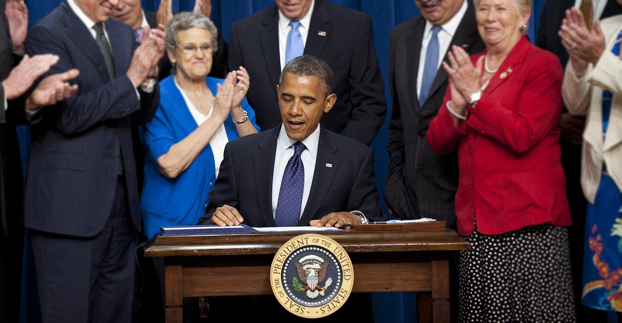 President Obama signs the reauthorization of the Export-Import Bank in 2012. (Photo: Newscom)