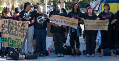 University of California, Irvine students stand in solidarity with the University of Missouri demonstrations, in Irvine, California, USA, 12 November 2015. Two University of Missouri officials recently stepped down after protests over alleged racist incidents at the campus. (Photo: Eugene Garcia/EPA/Newscom)