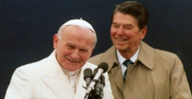 President Ronald Reagan and Pope John Paul II at a press conference in Anchorage, Alaska on May 2, 1984. According to United States Conference of Catholic Bishops, this marked the first time a U.S. president and pope met outside of the White House or Vatican. (Photo: UPI/Newscom)