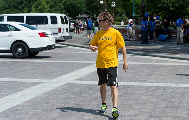 Paul takes a stroll across the East Plaza of the Capitol on Wednesday, June 5, 2013. (Photo By Bill Clark/CQ Roll Call)