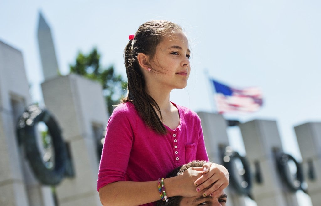 Addie Pearce, 9, honors the lives lost in World War II at a ceremony to mark the 70th anniversary of D-Day. (Photo: Tom Williams/CQ Roll Call)