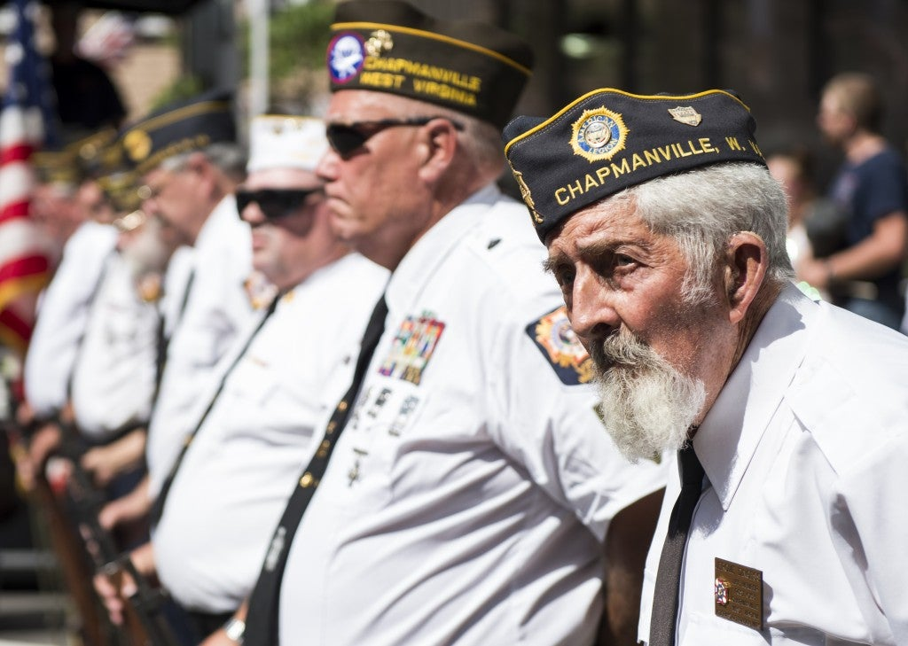 Local veterans stand in formation after firing rifles in salute during the presentation of the colors. (Photo: Bill Clark/CQ Roll Call/Newscom)
