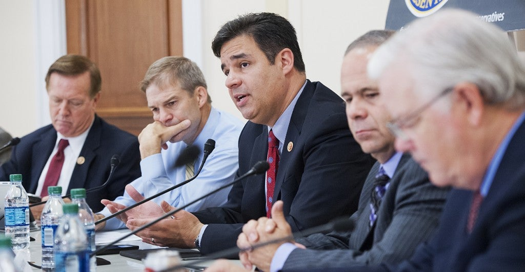 'That's extortion,' Rep. Raul Labrador, R-Idaho, said of President Obama's position on granting legal status to illegal immigrants. In this July photo, he is flanked by Jim Jordan of Ohio and Tim Huelskamp of Kansas.         (Photo: Tom Williams/CQ Roll Call/Newscom)