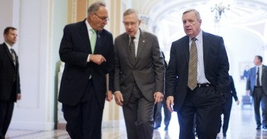 Senate Majority Whip Richard Durbin, D-Ill., far right, walks with Sen. Charles Schumer, D-N.Y., Senate Majority Leader Harry Reid, D-Nev., in the Capitol. (Photo: Tom Williams/CQ Roll Call)