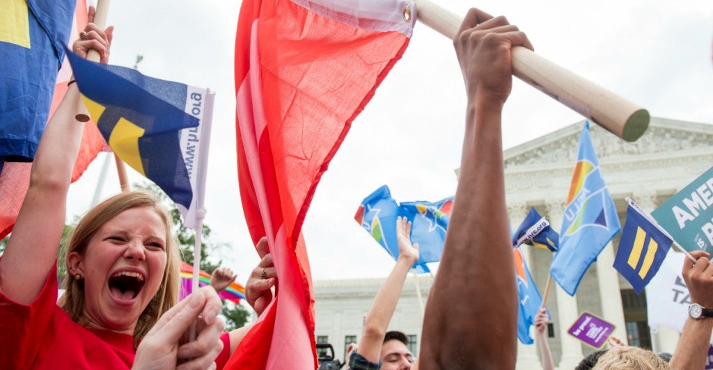 Demonstrators celebrate the U.S. Supreme Court ruling legalizing same-sex marriage. (Photo: Bill Clark/CQ Roll Call/Newscom)
