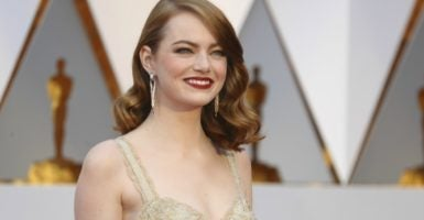 "Actress Emma Stone, who starred in ""La La Land,"" chooses to show support for Planned Parenthood in her Oscars attire. (Photo: Mike Blake/Reuters /Newscom)"