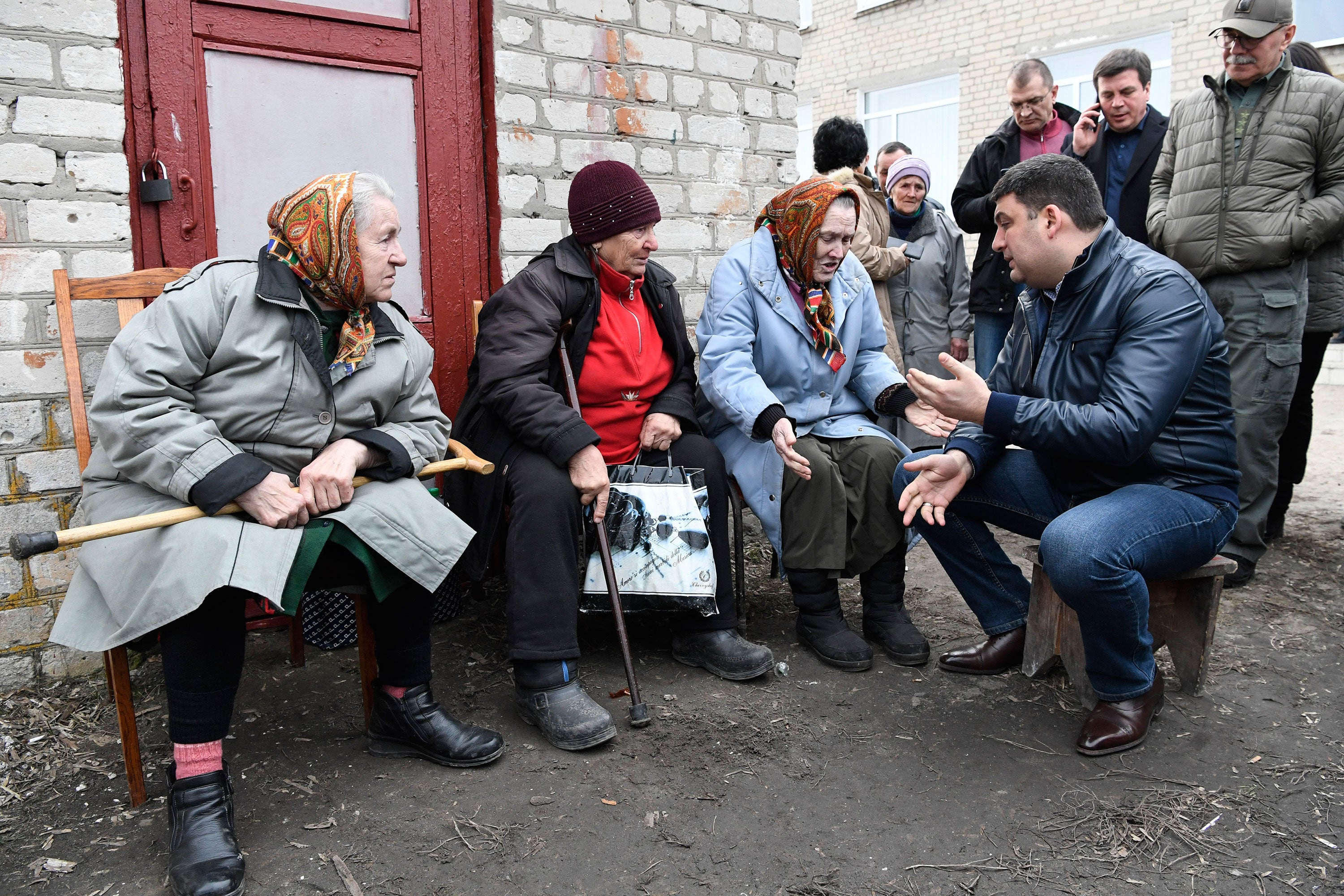 Ukrainian Prime Minister Volodymyr Groysman meets with local residents at a collection point for evacuees after ammunition detonated at a military base in the town of Balaklia, Ukraine, March 23, 2017. (Photo: Pool/Reuters/Newscom)