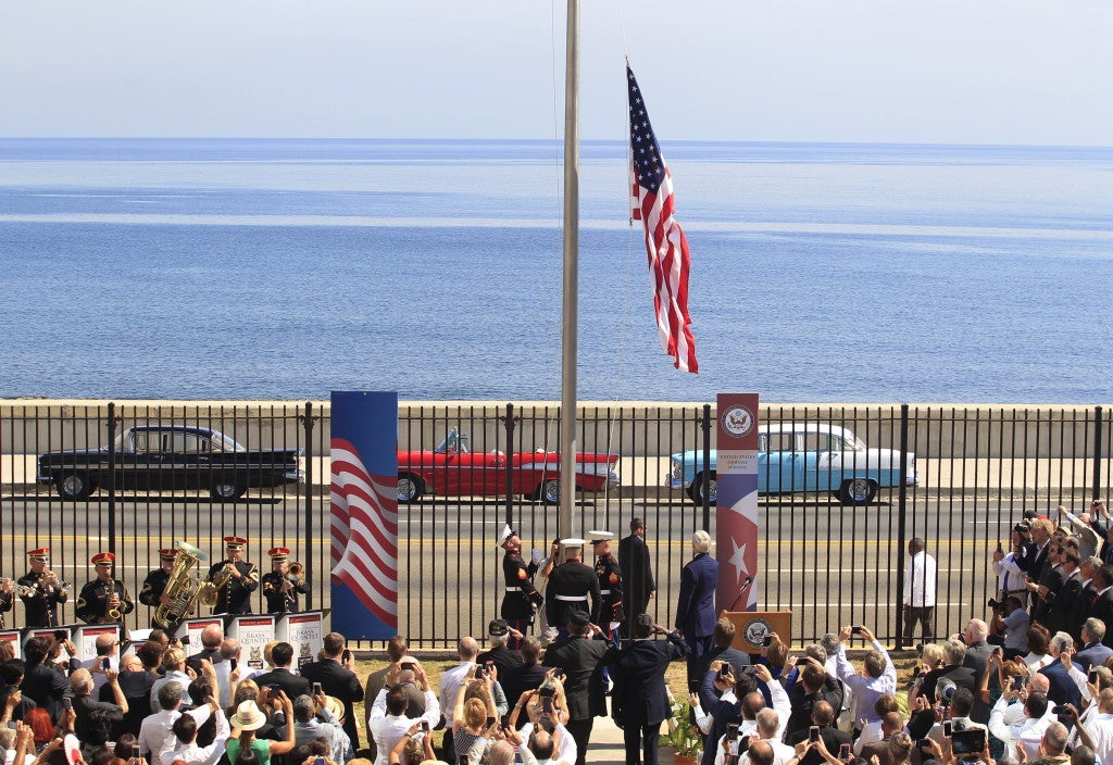U.S. marines raise the American flag at the U.S. embassy in Havana, Cuba while Secretary of State John Kerry watches. (Photo: Stringer/Reuters/Newscom)