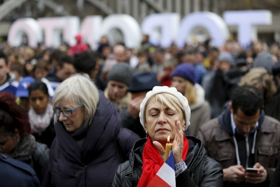 Lena Polyvyannaya of Toronto closes her eyes during a moment of silence outside city hall in Toronto, Canada. (Photo: REUTERS/Chris Helgren/Newscom)