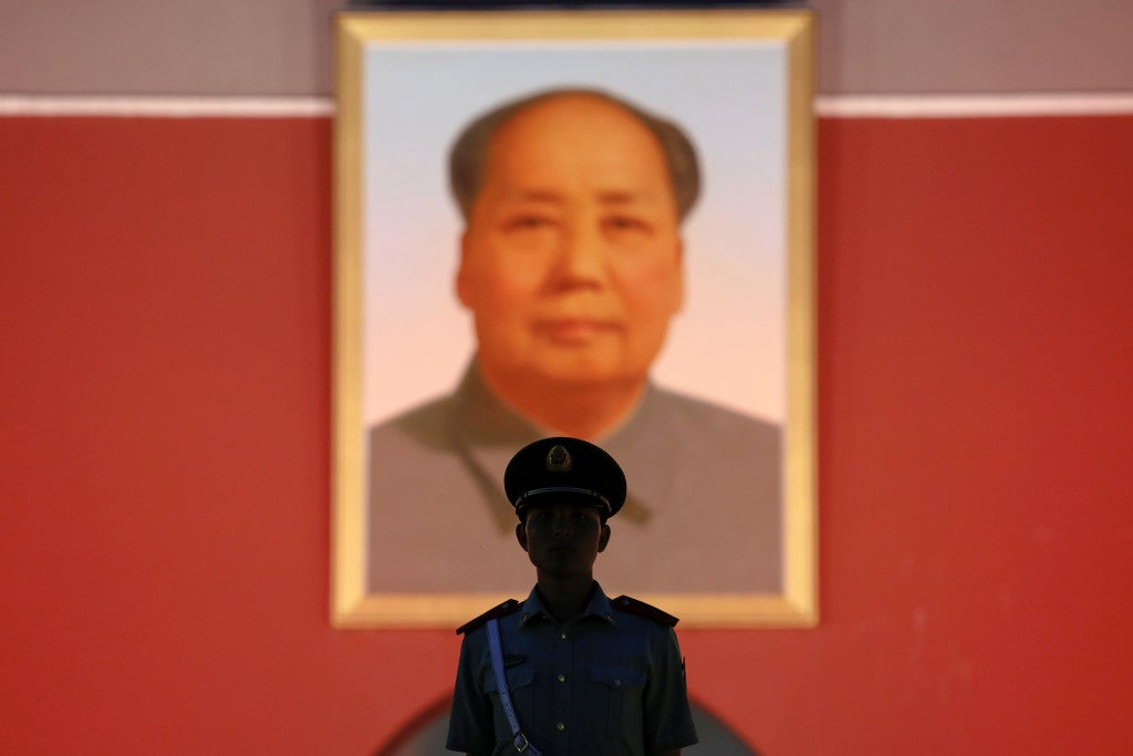 A paramilitary guard stands under a giant portrait of late Chinese Chairman Mao Zedong at the Tiananmen gate in Beijing, China June 3, 2016. (Photo: Damir Sagolj / Reuters/Newscom)