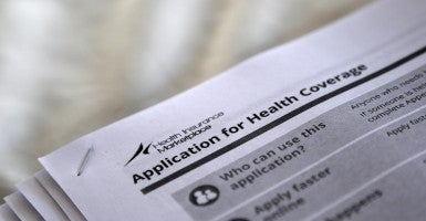 The federal government forms for applying for health coverage. (Photo: Jonathan Bachman/Reuters/Newscom)