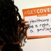 A woman writes her thoughts about Obamcare at the White House Youth Summit. (Photo: Kevin Lamarque /Reuters/Newscom)