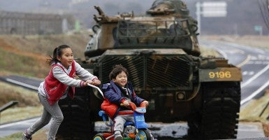Children play in front of a tank on the island of Baengnyeong, which lies on the South Korean side of the Northern Limit Line. The beaches of Baengnyeong are often walled with barbed wire fences straddling the sand dunes with intermittent holes for machine gun positions. (Photo: Damir Sagolj/Newscom)