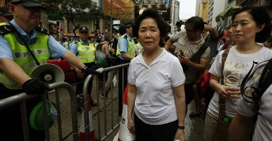 'All we are asking is for Beijing to adhere to the promises they made,' former Hong Kong Chief Secretary Anson Chan says. (Photo: Bobby Yip/Newscom)
