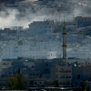 Smoke rises from the Syrian town of Kobani, on Oct. 20, 2014. The U.S. military said it had air-dropped arms to Syrian rebels fighting Islamic State militants near Kobani recently. (Photo: Kai Pfaffenbach/Reuters/Newscom)