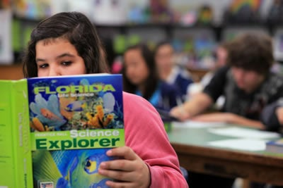 7th grade student reads book in life science class in St. Petersburg, Florida