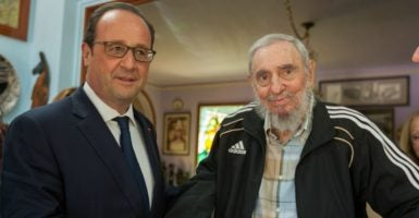 French President Francois Hollande talking with Cuban dictator Fidel Castro during a meeting in 2015. (Photo: Alex Castro/Cuba Debate/SIPA/Newscom)