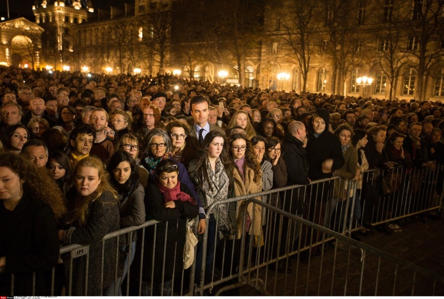 People gather outside of the Notre-Dame cathedral to attend a mass in Paris, France. (Photo: Xinhua/Xu Jinquan)
