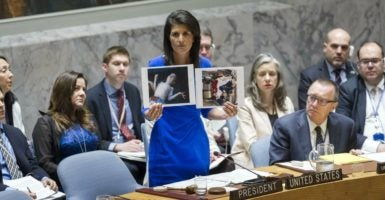 U.N. Ambassador Nikki Haley holds up photos of victims of the chemical weapons attack in Syria during her remarks Wednesday to the  United Nations Security Council. (Photo: UN Photo/Rick Bajornas/Sipa/Newscom)
