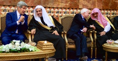 Secretary of State John Kerry and Sen. John McCain, R-Ariz. chat with members of the Saudi Royal Family after greeting the new King Salman of Saudi Arabia. (Photo: State Department/Sipa USA/Newscom)