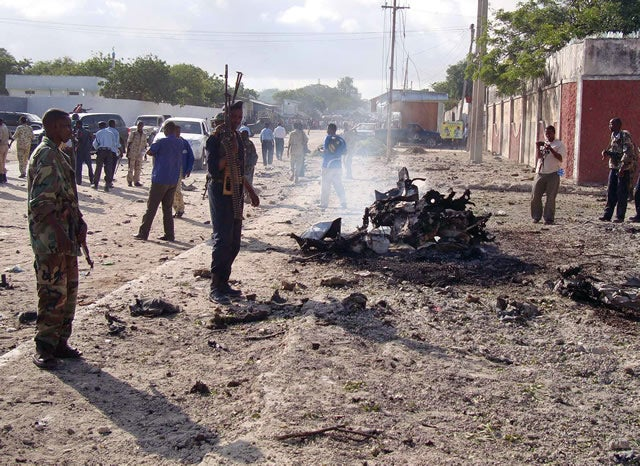 Somalia government soldiers secure the scene of a suicide attack that killed at least three people on October 18, 2011 in Somalia's wartorn capital, Mogadishu. AFP PHOTO / Abdiwahab Haji