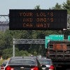 Massachusetts chose to post this message on their electronic highway billboards targeting drivers who feel the need to text and drive. (Photo: Newscom)