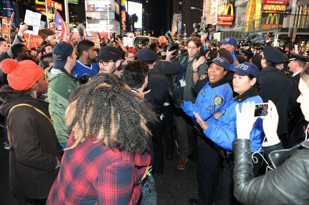A large group of protesters demonstrating in Times Square. (Photo: Christopher Sadowski/Newscom)
