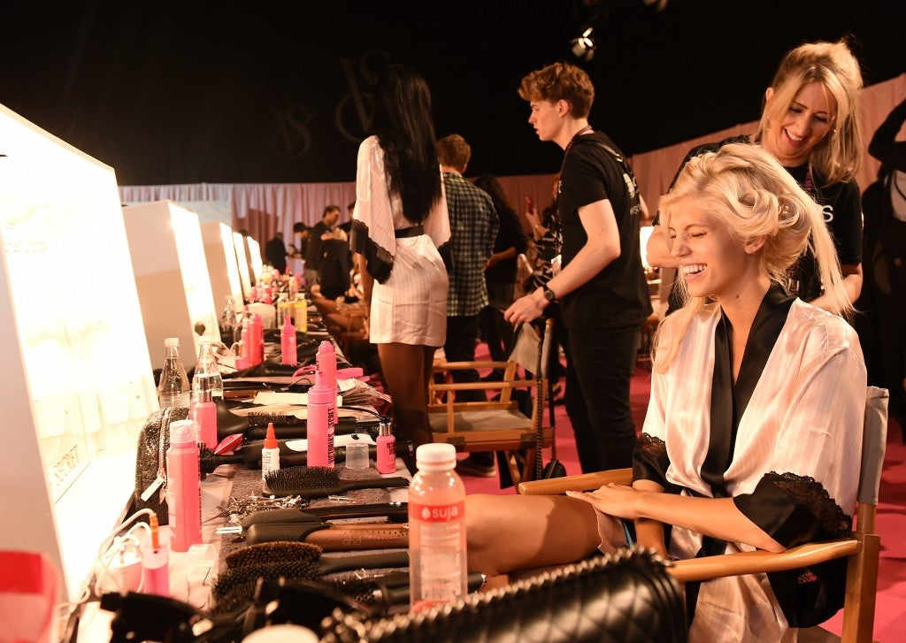 Backstage hair and makeup. (Photo: Newscom)