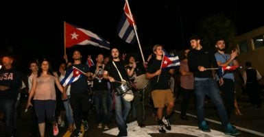 Some in the Cuban population of Miami gather in Little Havana on 8th Street to celebrate the death of Fidel Castro, Cuba's longtime communist dictator. (Photo: Jeff Binion/Newscom)
