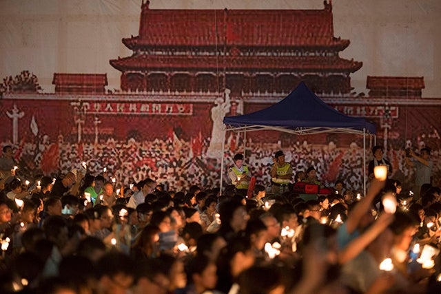 Participants hold candles during a vigil to commemorate the 25th anniversary of the Tiananmen Square crackdown in Hong Kong, China on June 4, 2014. Hong Kong is the only place on Chinese soil where large scale events to commemorate the tragic day.
