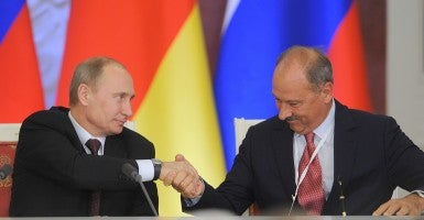 "Russia's president Vladimir Putin and VEB Bank (Vnesheconombank) head Vladimir Dmitriyev signing joint documents following Russian-German talks, at Moscow's Kremlin in Nov. 2012. The Export-Import Bank and VEB even signed a Memorandum of Understanding in 2010 in recognition of the ""long-standing partnership"" between the two state agencies. (Photo: Newscom)"
