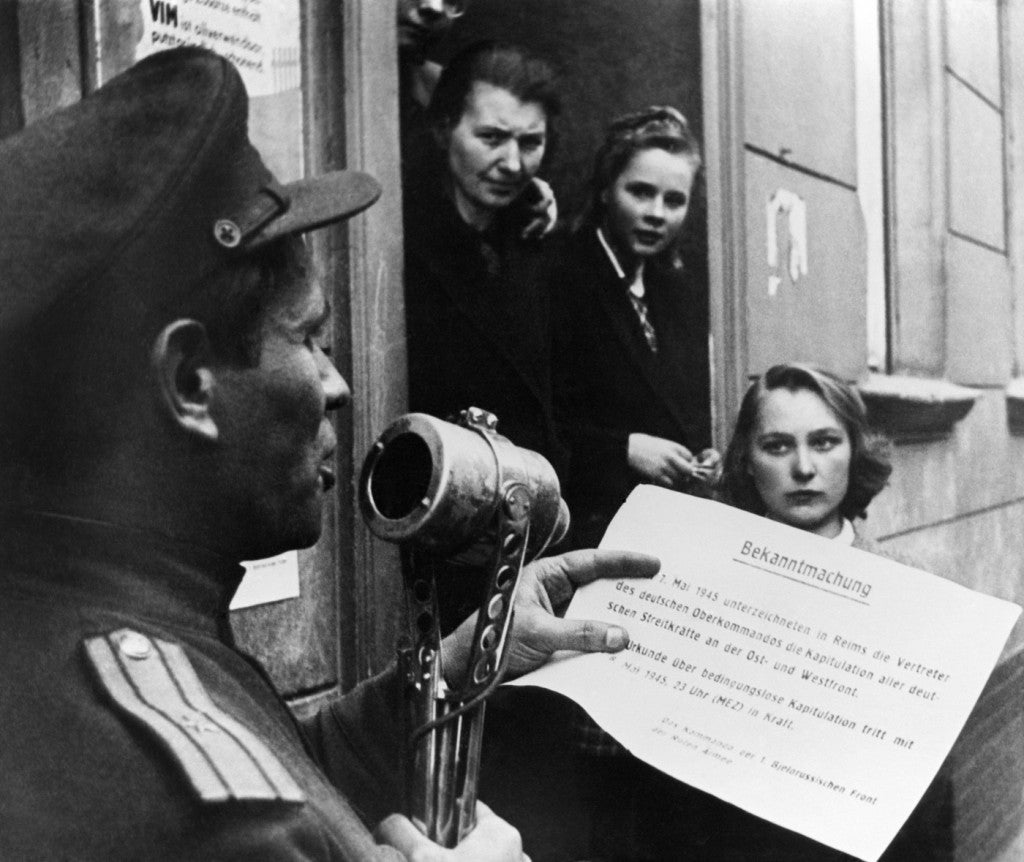 A Soviet officer reads the text of the German instrument of surrender. (Photo: TASS/Valery Faminsky/Newscom)