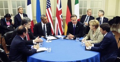 French President Francois Hollande, Ukrainian President Petro Poroshenko, US President Barack Obama, British Prime Minister David Cameron, and German Chancellor Angela Merkel (L-R) meet for talks at the NATO summit in Newport, Wales. (Photo: Mikhail Palinchak/Newscom)
