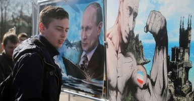 "Russian President Vladimir Putin's posters are on display at an exhibition, ""Crimea: The return to its native harbor,"" in Moscow's Novopushkinsky Park. The exhibition marks the first anniversary of the 2014 Crimean status referendum. (Photo: Sergei Fadeichev/TASS/Newscom)"
