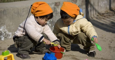 Two small Chinese children play. (Photo: iStockphoto)