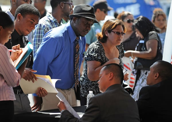 Job seekers talk to employers at a south Los Angeles job fair.