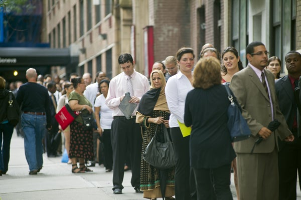 Job seekers line up for a job fair in midtown in New York on Monday, August 15, 2011. (Frances M. Roberts)