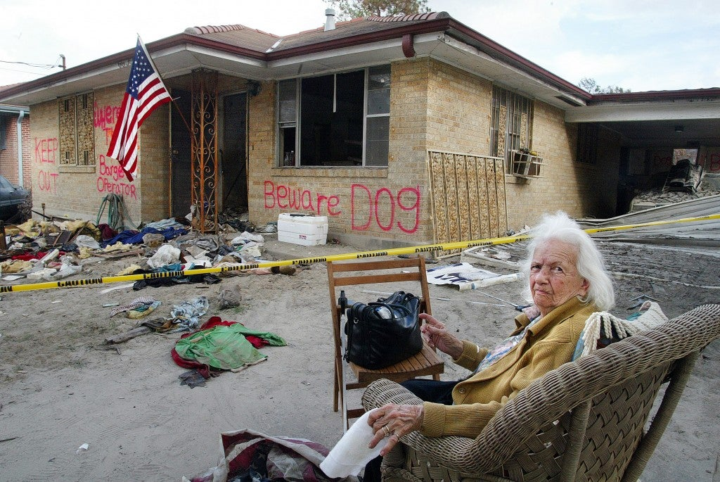 Ninety-one-year-old Catherine Carrere sits outside her home in New Orleans as relatives inside try to retrieve some of her belongings. Carrere said she had no flood insurance and doesn't know how she will rebuild her home. (Photo: A.J. Sisco/UPI Photo/Newscom)