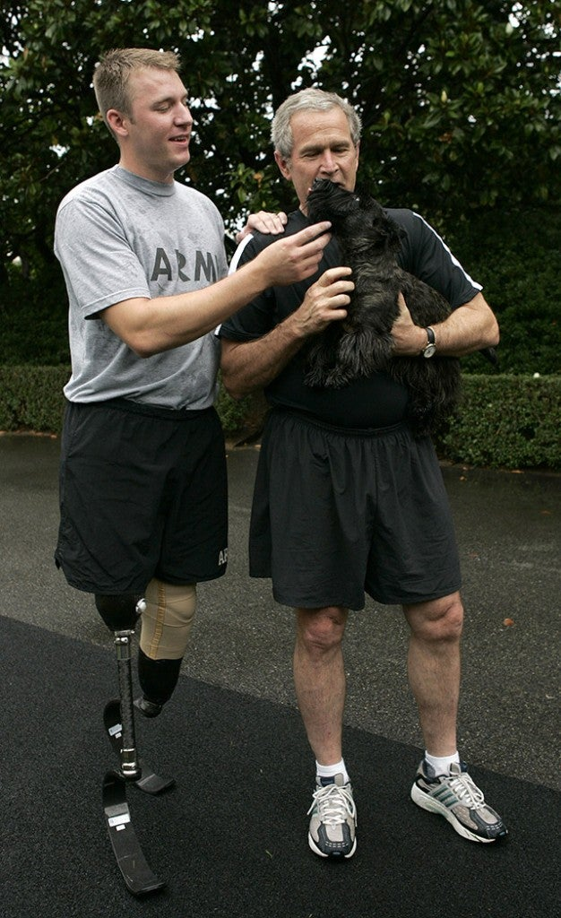 President Bush jogs around with double amputee