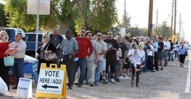 Voters wait hours to cast ballots in Arizona. (Photo: Newscom)