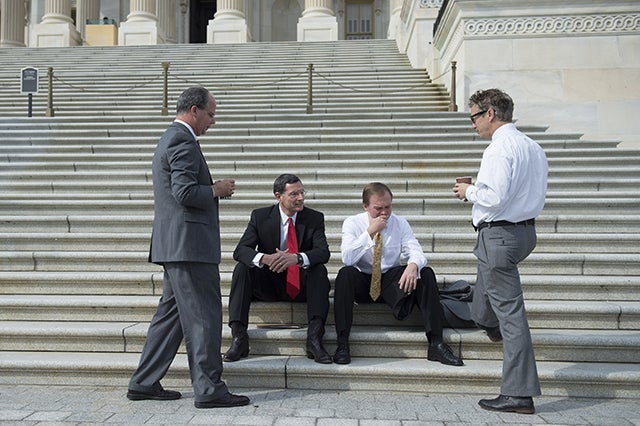 Rep. Brett Guthrie R-Ky., Sen. John Barrasso R-Wy. and Rep. Mike Mulvaney R-S.C. enjoy coffee on the steps of the Capitol with Paul. Paul invited members from both sides of the aisle for coffee and to talk about a way to end the government shutdown in October 2013. (Photo:  UPI/Kevin Dietsch/Newscom)