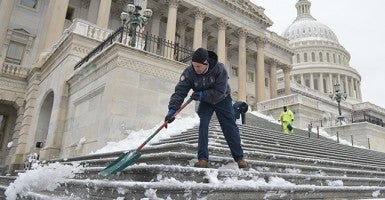 Workers clear snow from the steps of the U.S. Capitol Building on March 17 , 2014 in Washington, D.C. after a late-season overnight St. Patrick Day's storm left 5-10 inches on the Washington Metro region.  (Photo: UPI/Kevin Dietsch)