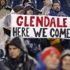 New England Patriots fans hold up a sign congratulating the team after they defeated the In