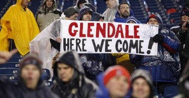 New England Patriots fans hold up a sign congratulating the team after they defeated the Indianapolis Colts 45-7 in AFC Championship Game. The Patriots will take on the Seattle Seahawks at Super Bowl XLIX in Glendale, Ariz. on Feb. 1, 2015. (Photo: Matthew Healey/Newscom)