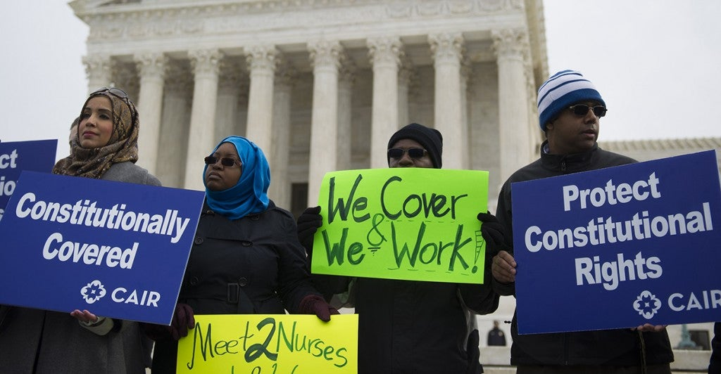 Supporters from The Council on American-Islamic Relations demonstrate outside the U.S. Supreme Court after the court heard oral arguments in EEOC v. Abercrombie & Fitch at the U.S. Supreme Court in Washington, D.C. on Feb. 25, 2015. (Photo: Kevin Dietsch/UPI/Newscom)
