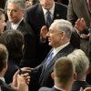 Israeli Prime Minister Benjamin Netanyahu makes his way past members of Congress as he arriv